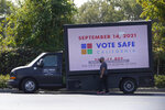 A truck with a digital sign reminding people of the Sept. 14 recall election is parked in a shopping center in Sacramento Calif., Thursday, Sept. 9, 2021. Democratic state lawmakers Sen. Steve Glazer and Assemblyman Marc Berman called for reforming the recall election requirements, Wednesday Sept. 15, 2021. This could include increasing the number of signatures to force a recall election, raising the standards to require malfeasance on the part of the office-holder and change the current process in which someone with a small percentage of votes could replace a sitting governor. (AP Photo/Rich Pedroncelli)