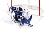 Tampa Bay Lightning's Anthony Cirelli (71) is unable to score past St. Louis Blues goaltender Jordan Binnington during the second period of an NHL hockey game Tuesday, Nov. 19, 2019, in St. Louis. (AP Photo/Jeff Roberson)