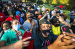 NBA star and current Winston-Salem State University student Chris Paul takes selfies with his fellow Rams as he leads a march to the early voting location on campus on Tuesday, Oct. 27, 2020, in Winston-Salem, N.C. (Andrew Dye/The Winston-Salem Journal via AP)