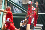 Washington Nationals manager Dave Martinez, right, with General Manager Mike Rizzo, back left, watch from the dugout a baseball intrasquad game at Nationals Park, Sunday, Aug. 2, 2020, in Washington. (AP Photo/Manuel Balce Ceneta)