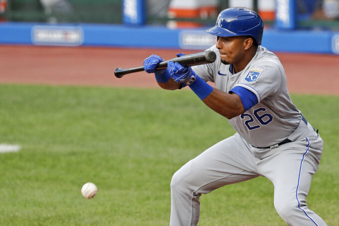 Kansas City Royals' Erick Mejia hits a sacrifice bunt in the 10th inning in a baseball game against the Cleveland Indians, Saturday, July 25, 2020, in Cleveland. Royals' Brett Phillips advanced to third base on the play. (AP Photo/Tony Dejak)