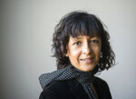 FILE -- In this March 14, 2016 file photo French microbiologist Emmanuelle Charpentier poses for a photo in Frankfurt, Germany. French scientist Emmanuelle Charpentier and American Jennifer A. Doudna have won the Nobel Prize 2020 in chemistry for developing a method of genome editing likened to 'molecular scissors' that offer the promise of one day curing genetic diseases. (Alexander Heinl/dpa via AP)