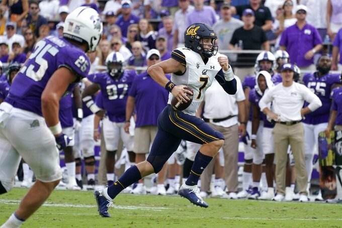 TCU linebacker Wyatt Harris (25) gives chase as California quarterback Chase Garbers (7) runs the ball in the second half of an NCAA college football game in Fort Worth, Texas, Saturday, Sept. 11, 2021. (AP Photo/Tony Gutierrez)