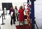 Broward Supervisor of Elections Dr. Brenda C. Snipes waves goodbye to the media, Sunday, Nov. 18, 2018, at the Broward Supervisor of Elections office in Lauderhill, Fla. Broward County reported their recount results with 52 minutes to spare Sunday. (Joe Cavaretta/South Florida Sun-Sentinel via AP)