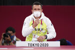 German coach Claudiu Pusa watch from the side during the women -70kg bronze medal judo match at the 2020 Summer Olympics in Tokyo, Japan, Wednesday, July 28, 2021. (AP Photo/Vincent Thian)