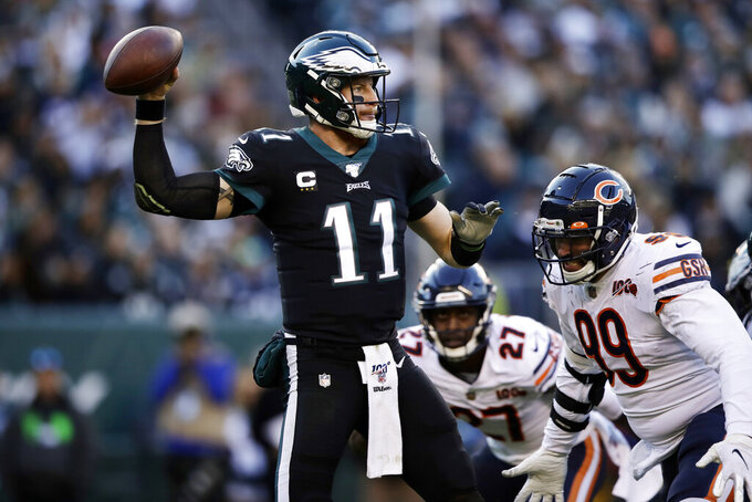 Philadelphia Eagles' Carson Wentz passes during the second half of an NFL football game against the Chicago Bears, Sunday, Nov. 3, 2019, in Philadelphia. (AP Photo/Matt Rourke)