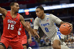Memphis forward D.J. Jeffries (0) drives against SMU forward Isiaha Mike (15) in the second half of an NCAA basketball game Saturday, Jan. 25, 2020, in Memphis, Tenn. (AP Photo/Brandon Dill)