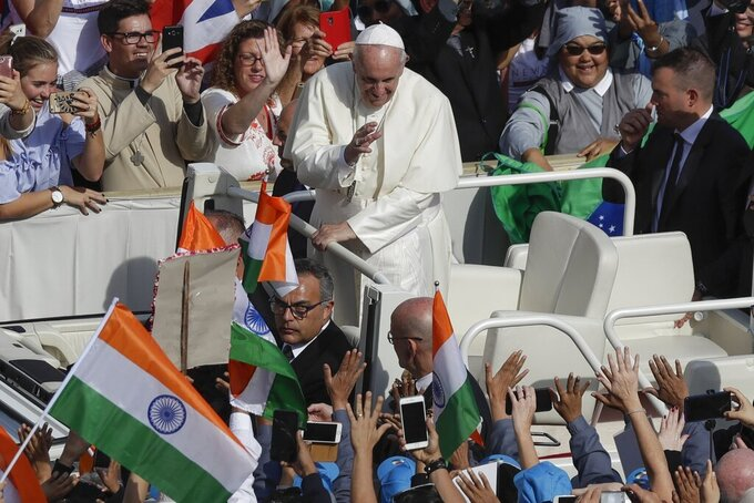 Pope Francis is driven through the crowd in St. Peter's Square at the Vatican, Sunday, Oct. 13, 2019. Francis presided over Mass on Sunday in a packed St. Peter's Square to declare Cardinal John Henry Newman and four women saints. (AP Photo/Alessandra Tarantino)