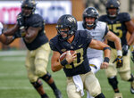 Wake Forest quarterback Sam Hartman carries the ball against Towson in the second half of an NCAA college football game in Winston-Salem, N.C., Saturday, Sept. 8, 2018. (AP Photo/Nell Redmond)