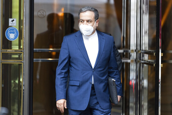 Political deputy at the Ministry of Foreign Affairs of Iran, Abbas Araghchi leaves the 'Grand Hotel Vienna' where closed-door nuclear talks take place in Vienna, Austria, Saturday, June 12, 2021. (AP Photo/Florian Schroetter)