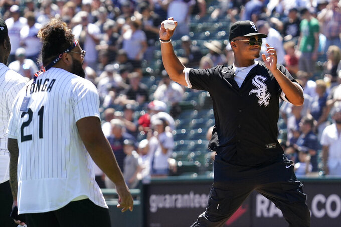 Chicago Bears quarterback Justin Fields, right, throws out a ceremonial first pitch before a baseball game between the New York Yankees and the Chicago White Sox in Chicago, Sunday, Aug. 15, 2021. (AP Photo/Nam Y. Huh)