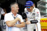 FILE - In this May 17, 2017, file photo, Gil de Ferran, left, talks with Fernando Alonso, of Spain, during a practice session for the Indianapolis 500 IndyCar auto race at Indianapolis Motor Speedway in Indianapolis. McLaren will return to full-time IndyCar competition next season for the first time since 1979 in a partnership with existing team Arrow Schmidt Peterson Motorsports. Gil de Ferran, the sporting director for McLaren Racing, will lead the IndyCar effort for McLaren independently from the Formula One effort. (AP Photo/Michael Conroy, File)