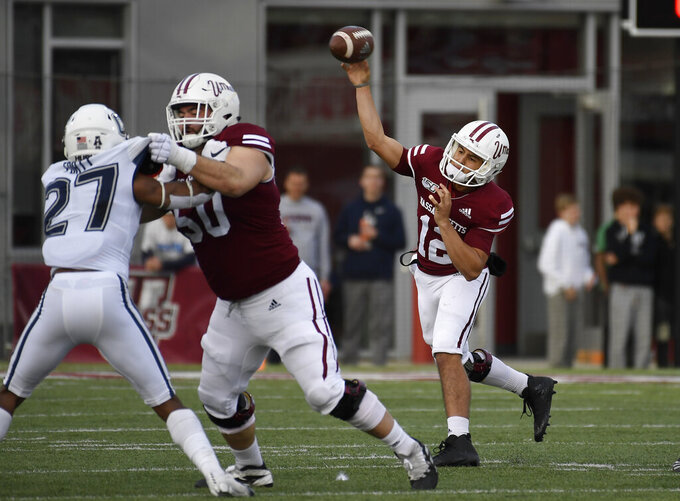Massachusetts quarterback Andrew Brito throws during the first half of an NCAA college football game against Connecticut, Saturday, Oct. 26,, 2019, in Amherst, Mass. (AP Photo/Jessica Hill)