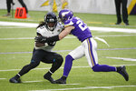 Jacksonville Jaguars wide receiver Laviska Shenault Jr. (10) tries to break a tackle by Minnesota Vikings safety Harrison Smith, right, after catching a pass during the first half of an NFL football game, Sunday, Dec. 6, 2020, in Minneapolis. (AP Photo/Bruce Kluckhohn)