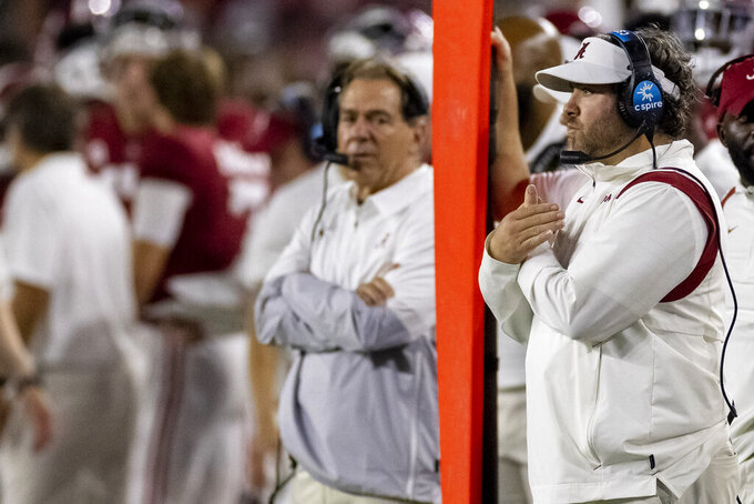Alabama defensive coordinator Pete Golding signals in during the second half of an NCAA college football game against Southern Mississippi, Saturday, Sept. 25, 2021, in Tuscaloosa, Ala. (AP Photo/Vasha Hunt)
