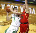 Arizona Oregon's Payton Pritchard, left, is fouled going to the basket by Arizona's Alex Barcello, right, during the second half of an NCAA college basketball game Saturday, March 2, 2019, in Eugene, Ore. (AP Photo/Chris Pietsch)