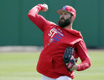 Philadelphia Phillies pitcher Jake Arrieta throws during a work out before a spring baseball exhibition game against the Tampa Bay Rays, Tuesday, March 13, 2018, in Clearwater, Fla. (AP Photo/John Raoux)