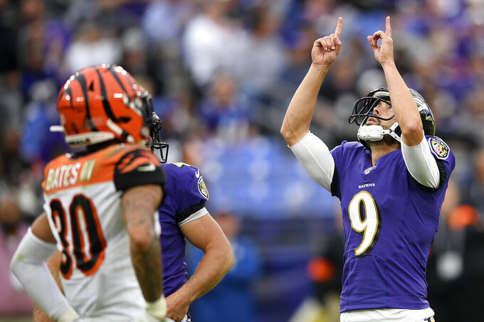 Baltimore Ravens kicker Justin Tucker gestures after kicking a field goal against the Cincinnati Bengals during the second half of a NFL football game Sunday, Oct. 13, 2019, in Baltimore. (AP Photo/Nick Wass)