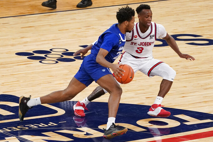 Seton Hall guard Jahari Long drives against St. John's guard Rasheem Dunn (3) during the second half of an NCAA college basketball game in the quarterfinals of the Big East conference tournament, Thursday, March 11, 2021, in New York. (AP Photo/Mary Altaffer)