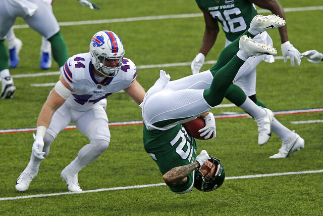 New York Jets safety Ashtyn Davis (32) is upended while returning a kick off with Buffalo Bills inside linebacker Tyler Matakevich (44) defending during the second half of an NFL football game in Orchard Park, N.Y., Sunday, Sept. 13, 2020. The Bills won 27-17. (AP Photo/John Munson)