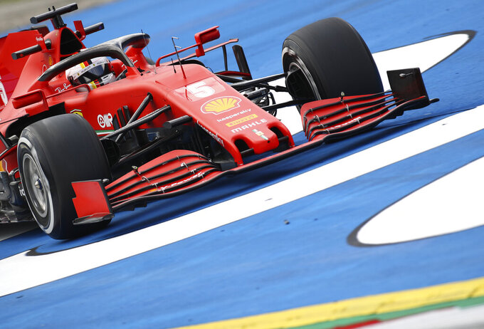 Ferrari driver Sebastian Vettel of Germany steers his car during the second practice session at the Red Bull Ring racetrack in Spielberg, Austria, Friday, July 3, 2020. The Austrian Formula One Grand Prix will be held on Sunday. (Mark Thompson/Pool via AP)