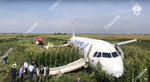 In this file image taken from a video distributed by Russian Investigative Committee, Investigative Committee employees works at a crash site of a Russian Ural Airlines' A321 plane is seen after an emergency landing in a cornfield near Ramenskoye, outside Moscow, Russia, Thursday, Aug. 15, 2019. The Russian pilot was being hailed as a hero Thursday for safely landing his passenger jet in a corn field after it collided with a flock of gulls seconds after takeoff, causing both engines to malfunction. While dozens of people on the plane sought medical assistance, only one was hospitalized. (The Investigative Committee of the Russian Federation via AP) EDS NOTE: Watermark placed on image at source translated as InvestCom