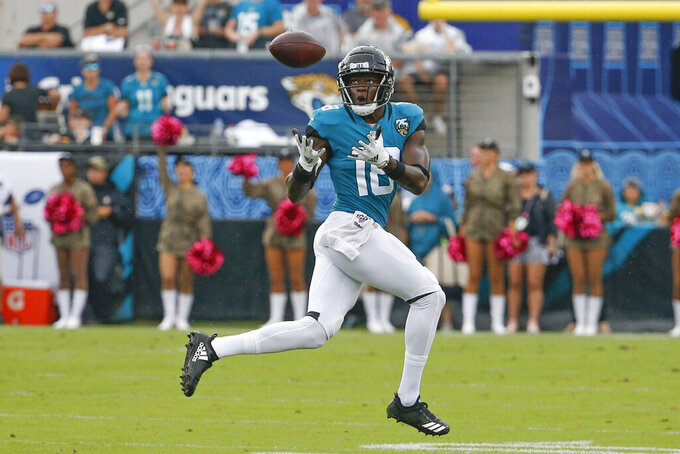 Jacksonville Jaguars wide receiver Chris Conley makes a reception on his way to a 70-yard touchdown against the New York Jets during the first half of an NFL football game, Sunday, Oct. 27, 2019, in Jacksonville, Fla. (AP Photo/Stephen B. Morton)
