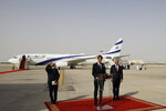FILE - In this Aug. 31, 2020 file photo, U.S. President Donald Trump's senior adviser Jared Kushner, center, speaks as Israeli National Security Advisor Meir Ben-Shabbat, left, and U.S. National Security Advisor Robert O'Brien stand by after an El Al plane from Israel landed in Abu Dhabi, United Arab Emirates.  For the first time in more than a quarter-century, a U.S. president will host a signing ceremony, Tuesday, Sept. 15, between Israelis and Arabs at the White House, billing it as an
