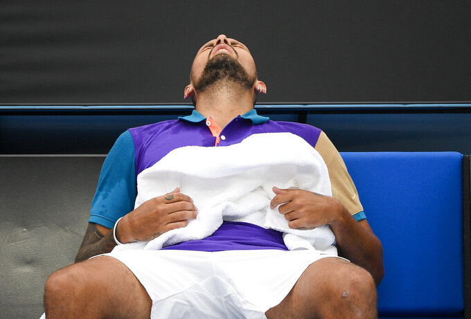 Australia's Nick Kyrgios reacts during a break in his match against France's Alexandre Muller at a tuneup tournament ahead of the Australian Open tennis championships in Melbourne, Australia, Tuesday, Feb. 2, 2021. (AP Photo/Andrew Brownbill)