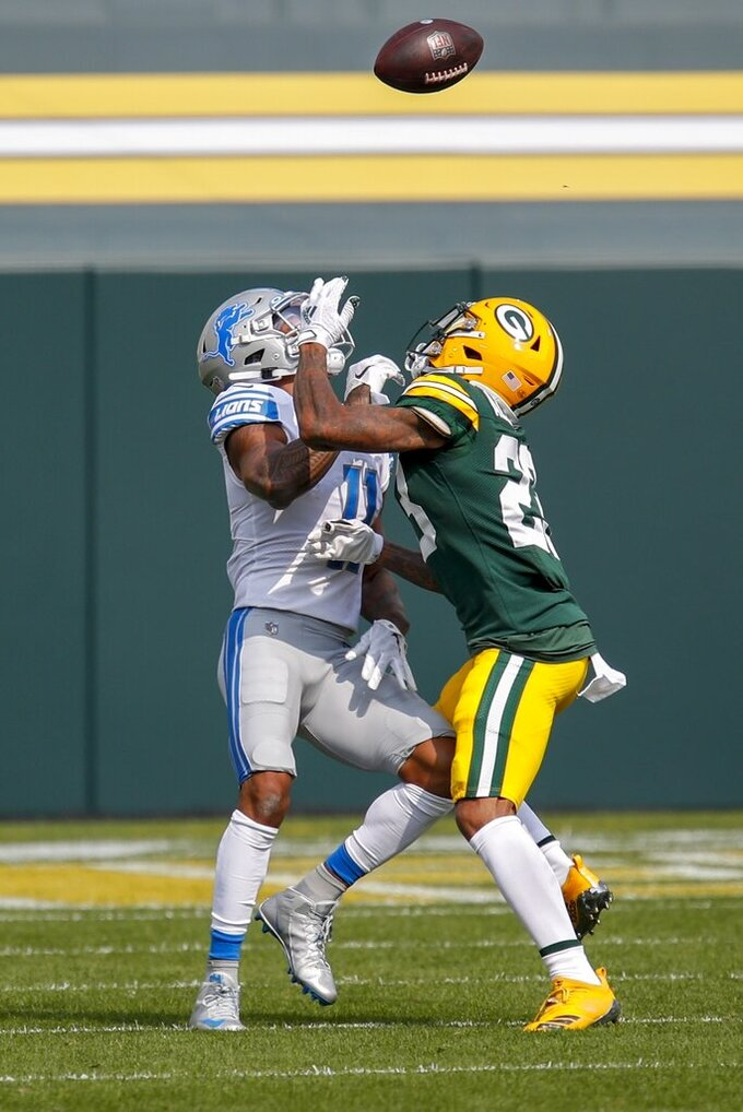 Detroit Lions' Marvin Jones catches a pass with Green Bay Packers' Jaire Alexander defending during the first half of an NFL football game Sunday, Sept. 20, 2020, in Green Bay, Wis. (AP Photo/Matt Ludtke)
