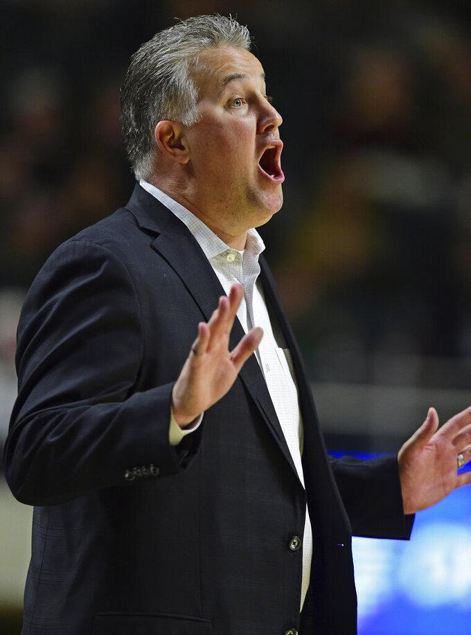 Purdue head coach Matt Painter disputes a call during the first half of an NCAA college basketball game against Ohio, Tuesday, Dec. 17, 2019, in Athens, Ohio. (AP Photo/David Dermer)