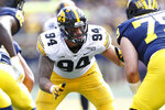 FILE - In this Oct. 5, 2019, file photo, Iowa defensive end A.J. Epenesa (94) plays against Michigan during the second half of an NCAA college football game in Ann Arbor, Mich. Patrick Queen of LSU and  Epenesa are potential picks by the Baltimore Ravens if GM Eric DeCosta chooses to address the linebacker position early in the draft. (AP Photo/Paul Sancya, File)