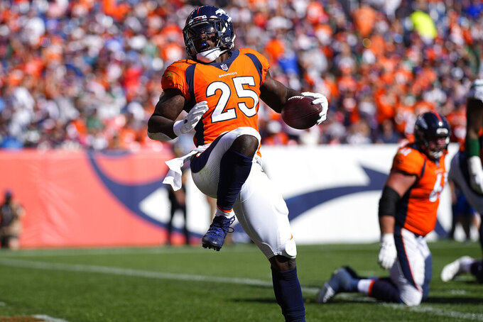 Denver Broncos running back Melvin Gordon (25) celebrates his touchdown against the New York Jets during the first half of an NFL football game, Sunday, Sept. 26, 2021, in Denver. (AP Photo/Jack Dempsey)