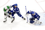 Dallas Stars' Joe Pavelski (16) and Tampa Bay Lightning's Ryan McDonagh (27) battle as Lightning goalie Andrei Vasilevskiy (88) makes a save during first-period NHL Stanley Cup finals hockey action in Edmonton, Alberta, Monday, Sept. 21, 2020. (Jason Franson/The Canadian Press via AP)