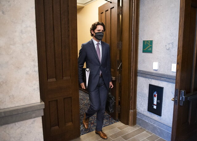 Canada's Prime Minister Justin Trudeau arrives in the foyer of the House of Commons on Parliament Hill for a meeting of the Special Committee on the COVID-19 Pandemic in Ottawa, Ontario on Wednesday, May 27, 2020. (Justin Tang/The Canadian Press via AP)