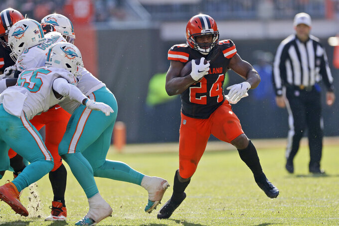 Cleveland Browns running back Nick Chubb (24) rushes during the first half of an NFL football game against the Miami Dolphins, Sunday, Nov. 24, 2019, in Cleveland. (AP Photo/Ron Schwane)