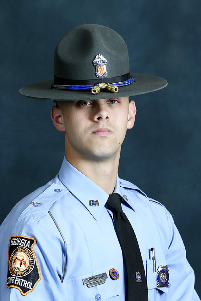 In this undated photo released by the Georgia Department of Public Safety, State trooper Jacob Gordon Thompson is seen in an official portrait. The Georgia Bureau of Investigation said in a statement Friday, Aug. 14, 2020 that Thompson was charged with felony murder and aggravated assault. The trooper has been fired and charged with murder a week after he fatally shot a 60-year-old man who attempted to flee a traffic stop. (Georgia Department of Public Safety via AP)