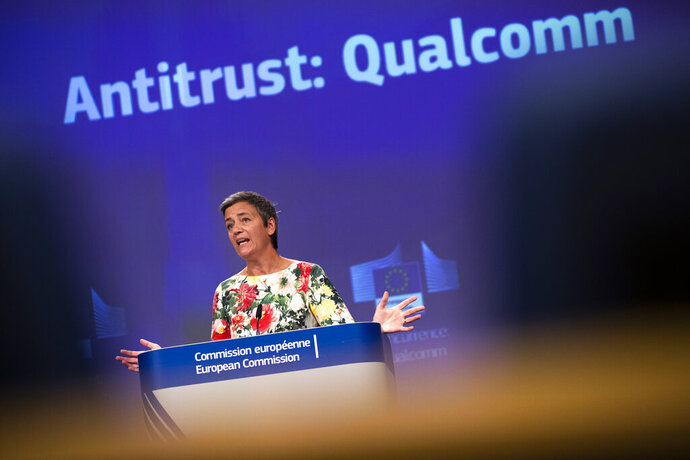 European Antitrust Commissioner Margrethe Vestager talks to journalists during a news conference at the European Commission headquarters in Brussels, Thursday, July 18, 2019. The European Union has fined U.S. chipmaker Qualcomm $271 million, accusing it of