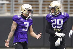 Washington defensive back Elijah Molden (3) talks with defensive back Julius Irvin (29) during NCAA college football practice, Friday, Oct. 16, 2020, in Seattle. (AP Photo/Ted S. Warren)