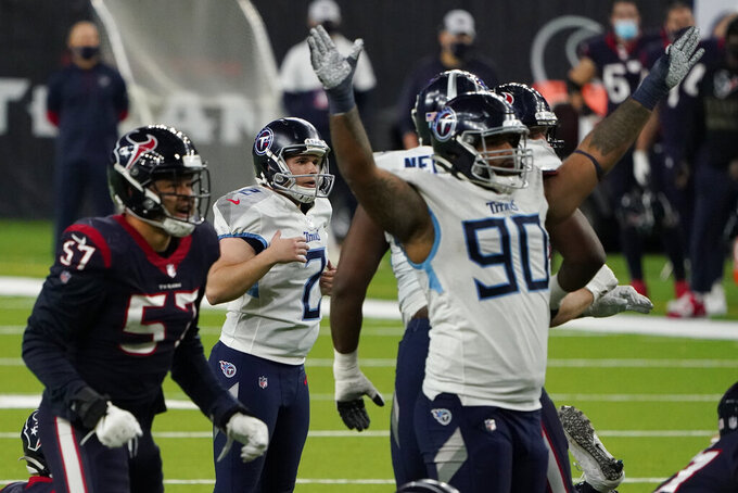 Tennessee Titans kicker Sam Sloman (2) watches his 37-yard game-winning field goal against the Houston Texans during the second half of an NFL football game Sunday, Jan. 3, 2021, in Houston. The Titans won 41-38. (AP Photo/Eric Christian Smith)