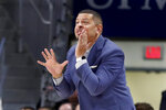 Pittsburgh coach Jeff Capel shouts to his team during the first half of an NCAA college exhibition basketball game against Slippery Rock on Wednesday, Oct. 30, 2019, in Pittsburgh. (AP Photo/Keith Srakocic)
