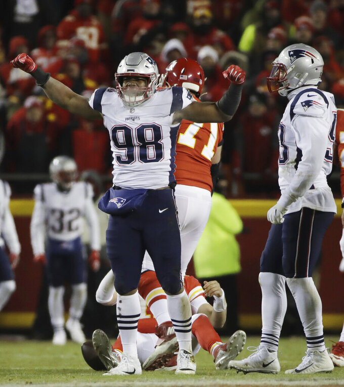 New England Patriots defensive end Trey Flowers (98) celebrates after sacking Kansas City Chiefs quarterback Patrick Mahomes during the first half of the AFC Championship NFL football game, Sunday, Jan. 20, 2019, in Kansas City, Mo. (AP Photo/Elise Amendola)