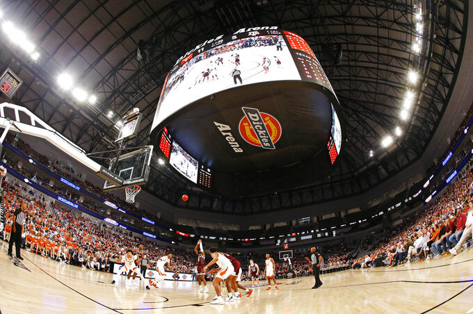 Texas A&M guard Jay Jay Chandler (0) shoots a free throw against Texas during the first half of an NCAA college basketball game, Sunday, Dec. 8, 2019, in Fort Worth, Texas. (AP Photo/Ron Jenkins)