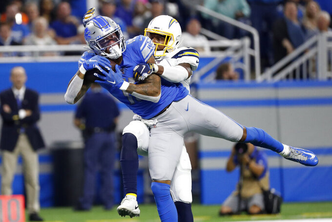 Detroit Lions wide receiver Kenny Golladay (19) pulls in a 31-yard touchdown reception as Los Angeles Chargers cornerback Casey Hayward defends in the second half of an NFL football game in Detroit, Sunday, Sept. 15, 2019. (AP Photo/Rick Osentoski)