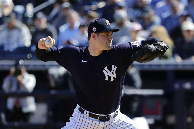 FILE - In this Feb. 29, 2020, file photo, New York Yankees' Adam Ottavino delivers a pitch during the fifth inning of a spring training baseball game against the Detroit Tigers in Tampa, Fla. The Yankees made a rare trade with the rival Boston Red Sox, sending struggling reliever Ottavino to Boston along with minor league right-hander Frank German for a player to be named or cash. (AP Photo/Frank Franklin II, File)