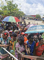 People line up to vote in Buka, the Autonomous Region of Bougainville, Papua New Guinea, Saturday, Nov. 23, 2019, in a historic referendum to decide if they want to become the world's newest nation by gaining independence from Papua New Guinea. (Post Courier via AP)