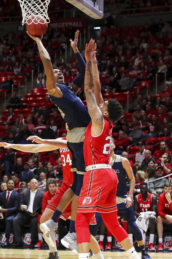 Nevada forward Jordan Brown (21) shoots the ball over Utah forward Timmy Allen (20) during the first half of an NCAA college basketball game, Saturday, Dec. 29, 2018, in Salt Lake City. (AP Photo/Chris Nicoll)