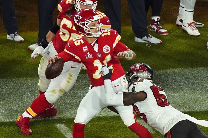 Kansas City Chiefs quarterback Patrick Mahomes (15) is pressured by Tampa Bay Buccaneers' Shaquil Barrett (58) during the second half of the NFL Super Bowl 55 football game Sunday, Feb. 7, 2021, in Tampa, Fla. (AP Photo/Charlie Riedel)