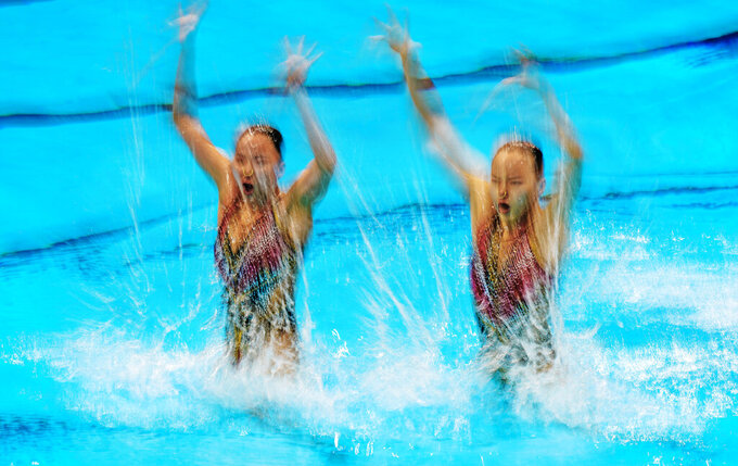 Huang Xuechen and Sun Wenyan of China compete in the duet technical routine at the the 2020 Summer Olympics, Tuesday, Aug. 3, 2021, in Tokyo, Japan. (AP Photo/Dmitri Lovetsky)