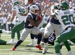New England Patriots running back Sony Michel, center, runs for a touchdown against the New York Jets in the first half of an NFL football game, Sunday, Sept. 22, 2019, in Foxborough, Mass. (AP Photo/Elise Amendola)